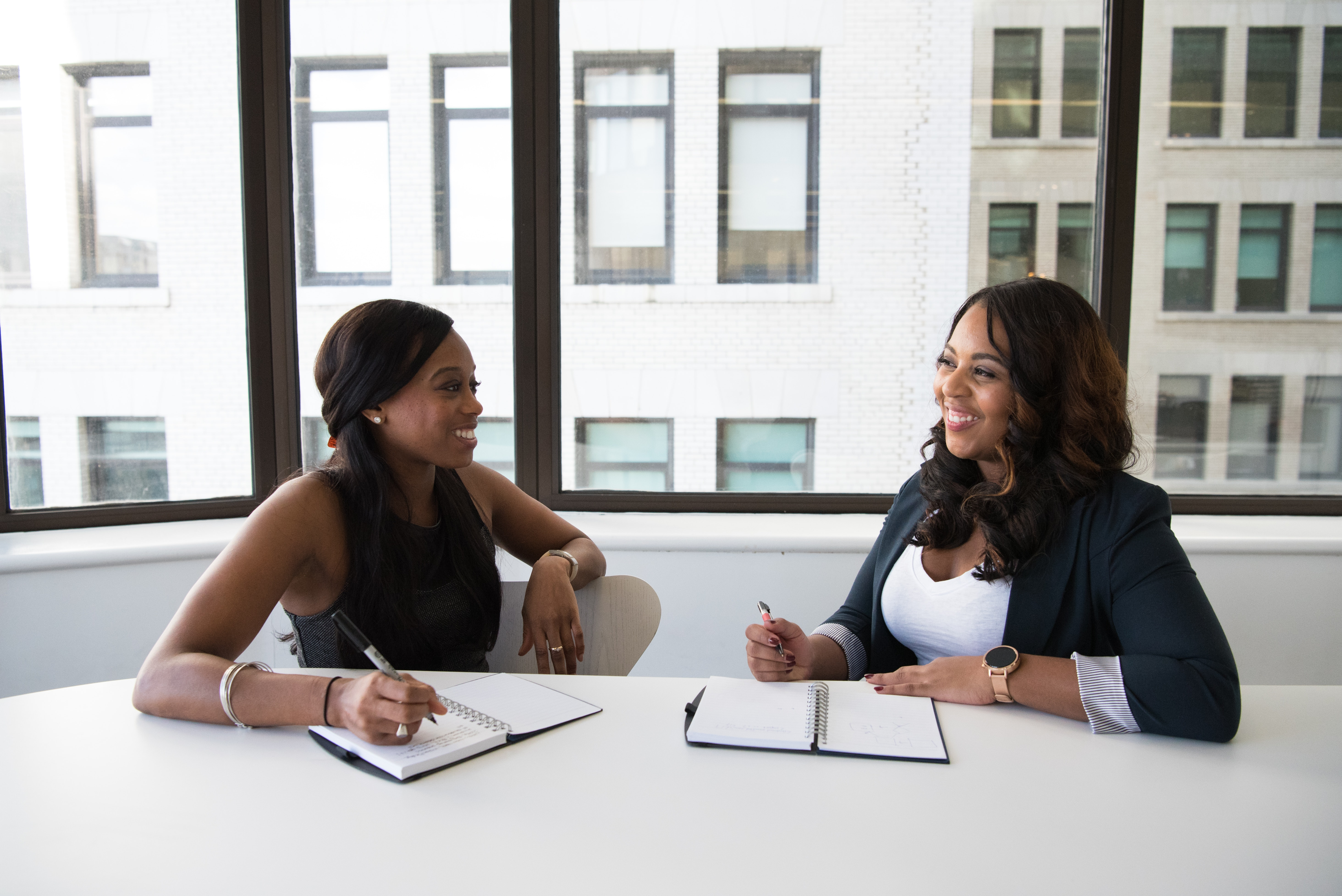 Two ladies speaking to each other in an office