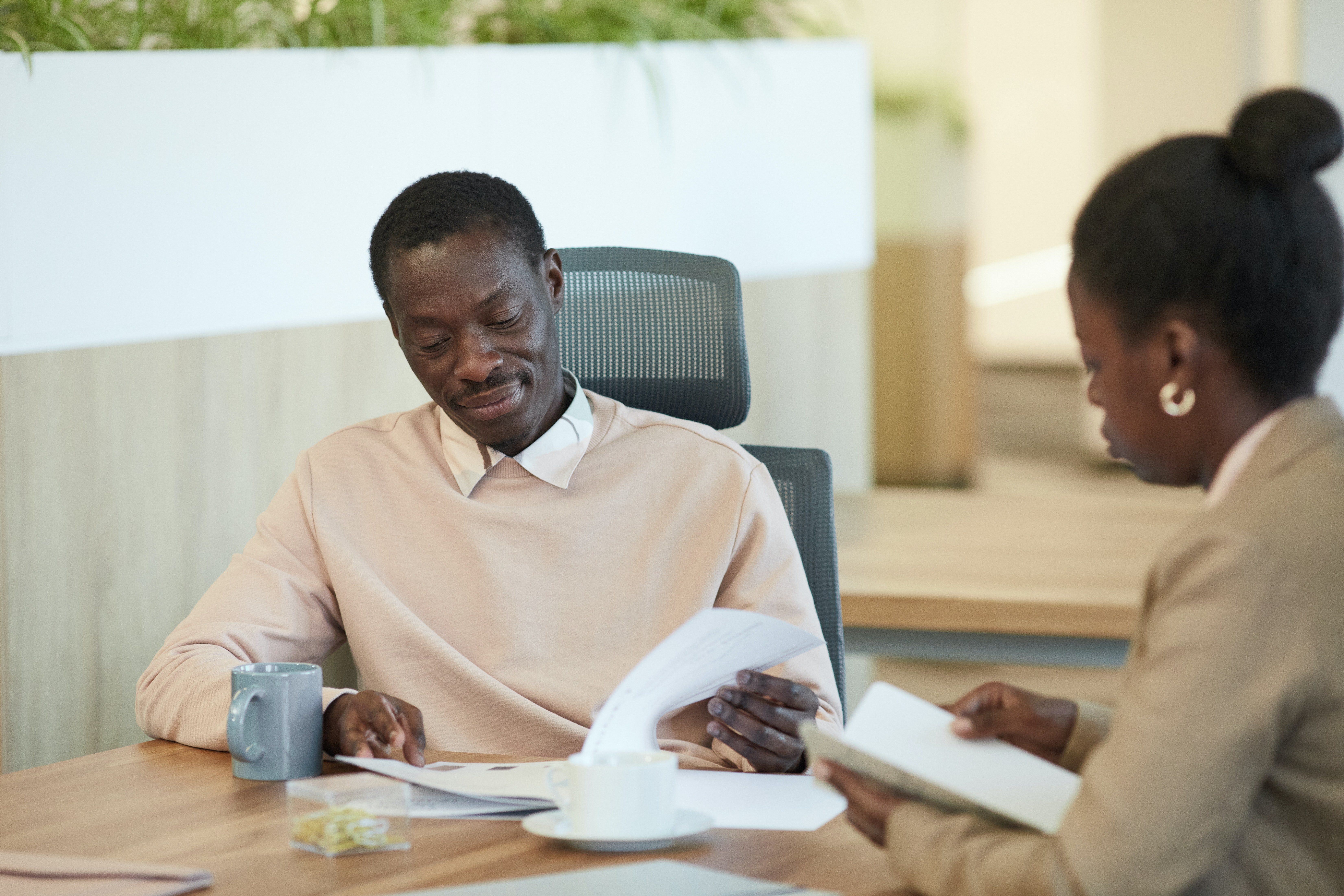 Man and women looking through documents in a business setting